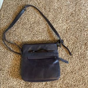 Brand new Wilson's leather side purse